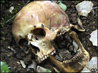 A crushed skull in a shallow grave in Podujevo