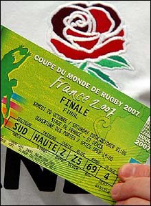 One lucky fan displays his ticket for the final
