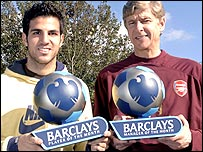 Arsenal's Cesc Fabregas (left) and Arsene Wenger show off their awards