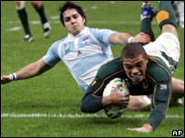 South Africa's Bryan Habana, foreground, scores his team's second try during the Rugby World Cup semi-final between South Africa and Argentina