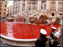 Trevi fountain in Rome dyed red