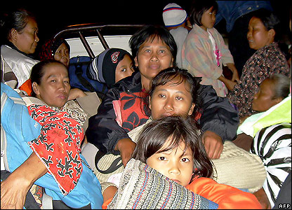 Evacuees on a lorry in East Java