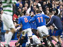 Barry Ferguson is mobbed by his team-mates