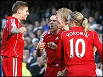 Liverpool celebrate Dirk Kuyt's first penalty at Everton