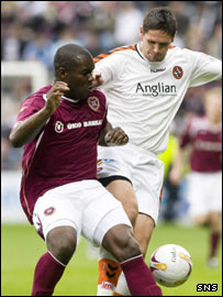 Christian Nade (left) and Lee Wilkie tussle