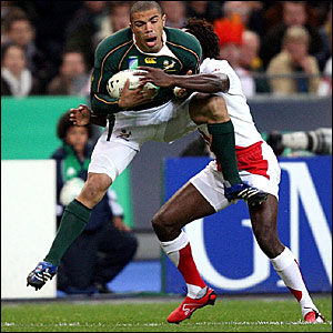 South Africa's Bryan Habana (green) is tackled by Paul Sackey