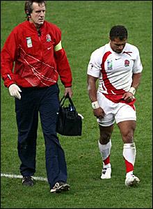 Jason Robinson (right) goes off injured