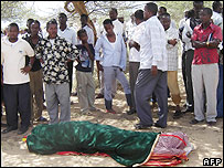 Bashir Nor Gedi 's body covered with a cloth shortly after his killing