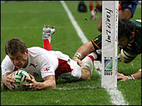 England winger Mark Cueto is judged to have put a foot in touch as he dives o