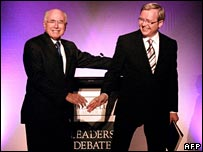 Australia PM John Howard greets election rival Kevin Rudd at the start of a TV debate on Sunday