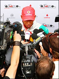 Lewis Hamilton is interviewed by the media