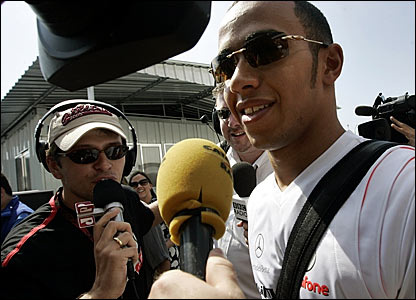 Lewis Hamilton is beseiged by the press at Interlagos