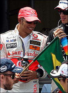 Lewis Hamilton with the Brazilian flag before the race