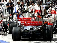 Fernando Alonso holds up Lewis Hamilton in the pits in qualifying at Hungary