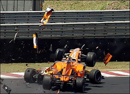 Spyker's Sakon Yamamoto spectacularly wipes out Renault's Heikki Kovalainen