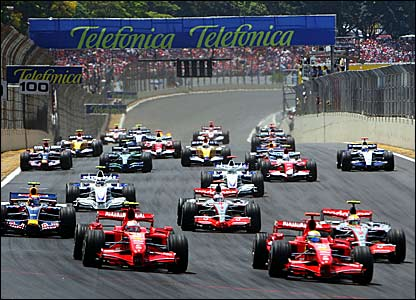 Felipe Massa (bottom right) leads from Ferrari team-mate Kimi Raikkonen (front left) with Lewis Hamilton in third