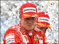 Kimi Raikkonen celebrates winning the Brazilian Grand Prix and the Formula One world title
