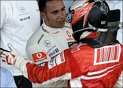 Lewis Hamilton (left) congratulates Kimi Raikkonen after the Finnish driver won the world title
