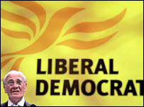 Liberal Democrat flag with Sir Ming Campbell
