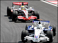 BMW Sauber's Nick Heidfeld leads Lewis Hamilton during the Brazilian Grand Prix