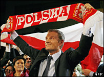 Donald Tusk celebrates after the exit polls are published