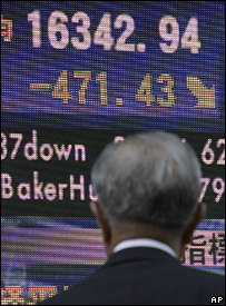 A Japanese man looks at stock market information in Tokyo