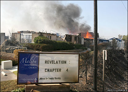 Malibu Presbyterian Church burns in one of several blazes across southern California on Sunday 21 October