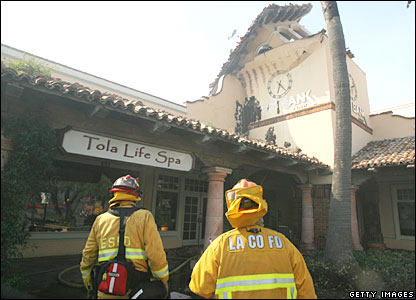 Firefighters examine damage near Malibu Colony shopping centre