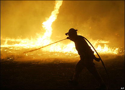 Firefighters from the Orange County Fire department hose a blaze near Irvine, California
