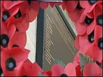 Poppy wreath and memorial plaque