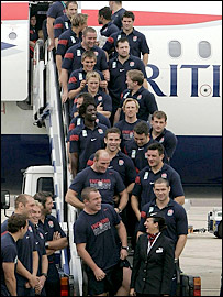 England's players return to Heathrow airport