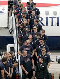 England's players return to Heathrow airport