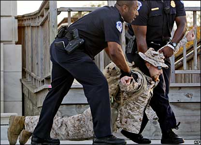 A demonstrator is arrested on Capitol Hill, 22 October 2007