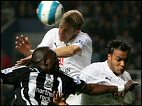 Tottenham defender Michael Dawson beats Abdoulaye Faye to a header