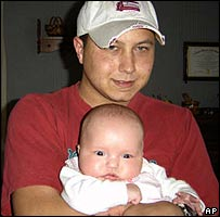 Zeb Stinnett holds his infant daughter, Victoria Jo Stinnett (image from 2005)