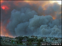 Smoke billows above Stevenson Ranch, California (22 October)
