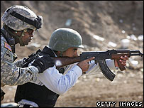 US soldier training an Iraqi police recruit