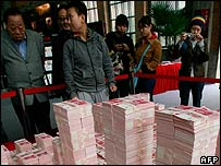 A model of Beijing's Central Business District (CBD), made up of 200,000 pieces of Chinese 100 yuan bank notes