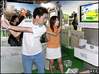 People playing a Wii game
