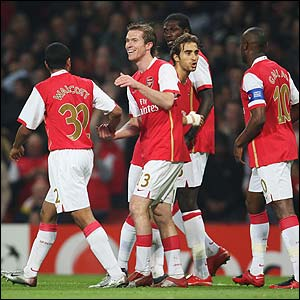 Arsenal's Alexander Hleb is congratulated by his team-mates