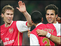 Alex Hleb, Theo Walcott and Cesc Fabregas celebrate