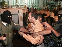 West Bank police detain Hamas supporters at a protest on 22 October