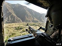 A US gunner looks out of a helicopter above Afghanistan, October 2007