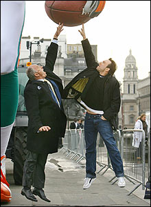 To show just how big the 26ft animatronic model is, Mayor of London Ken Livingstone and Hollywood actor Christian Slater jump up to contest the ball