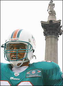 Stand aside Lord Nelson, the NFL is in town. London's most famous column is joined by a giant statue of Miami player Jason Taylor