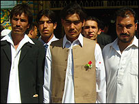 Afghan groom (centre)