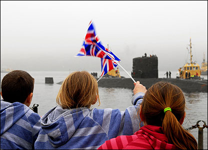 About 200 family and friends were at the base to welcome the crew home