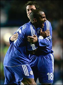 Chelsea's Florent Malouda is congratulated by team-mate Wayne Bridge