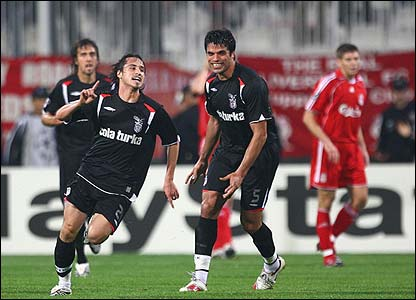 Serdar Ozcan celebrates after helping to create the opener for Besiktas