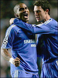 Florent Malouda is congratulated on his opener by Wayne Bridge